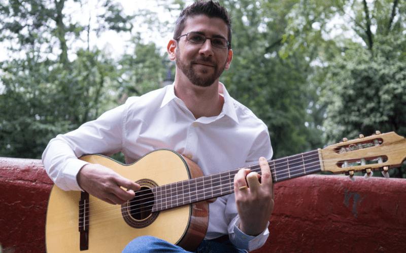 Musical U Christopher Sutton playing guitar
