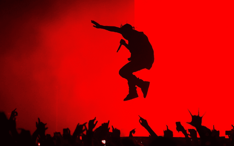 kanye west performing on stage silhouette