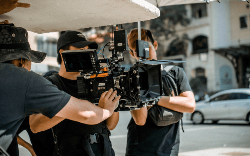 red film camera with director and cinematographer