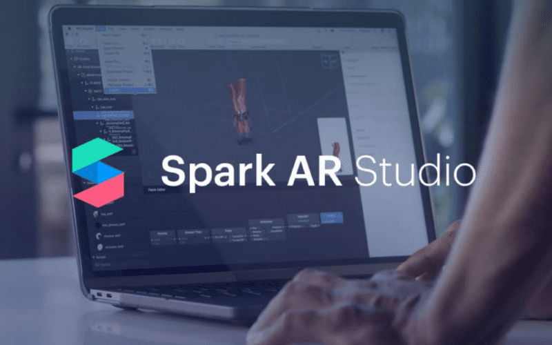 Spark AR Studio logo with man creating filter in background.
