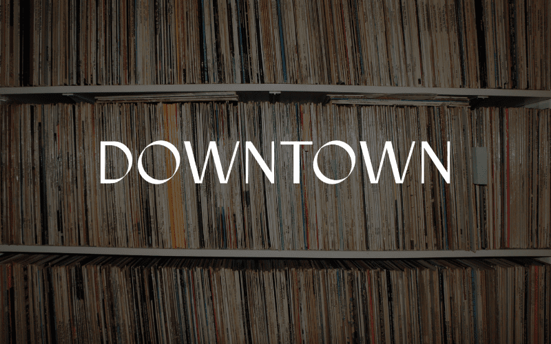 Downtown music publishing logo with vinyls in the back.