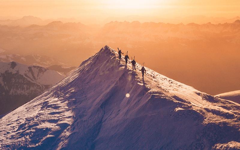 establishing shot people on mountains drone shot
