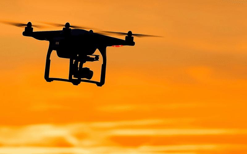Drone film guide silhouette in golden hour
