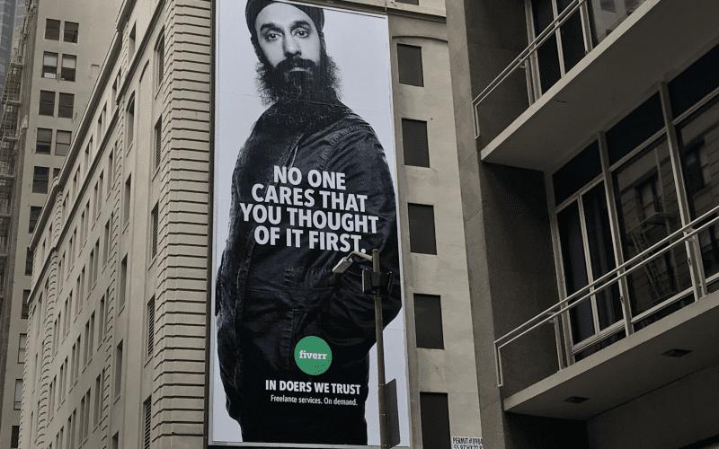 A long billboard advertising Fiverr. fiverr.com.
