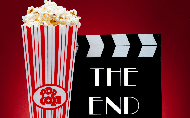 movie the end with clapboard and popcorn