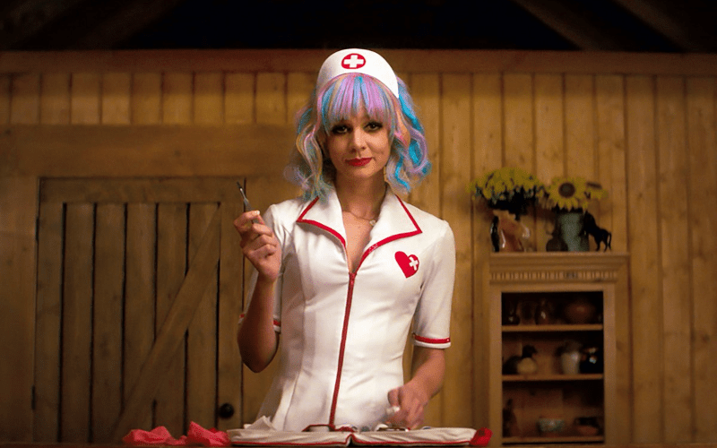 Cassie from promising young woman in a pretend nurse outfit holding a scapel.