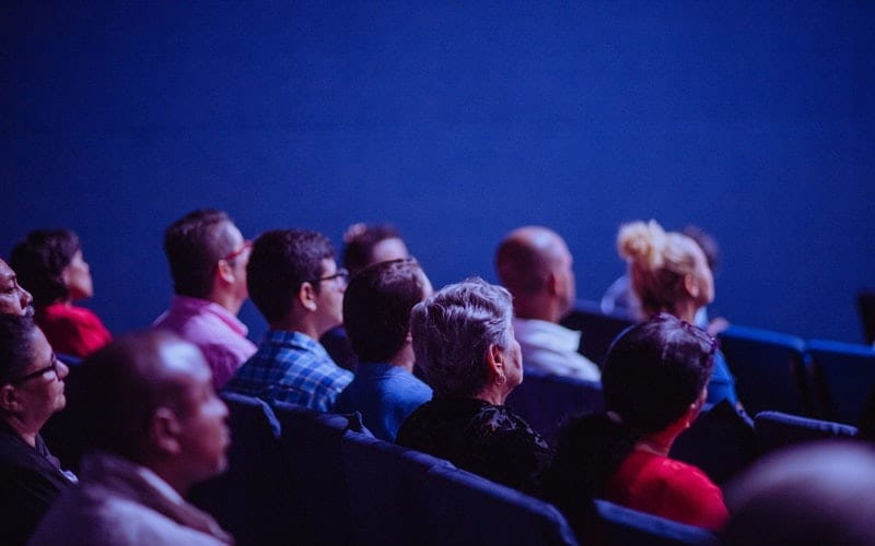 audience watching in a theatre