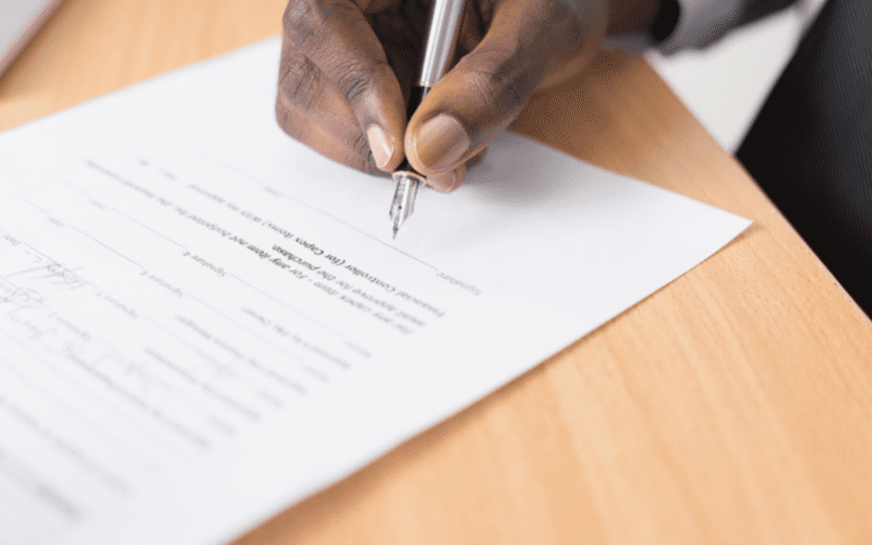 man signing a contract music split sheet