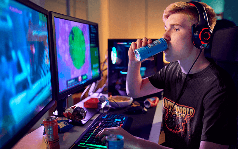 gamer drinking energy drink while playing