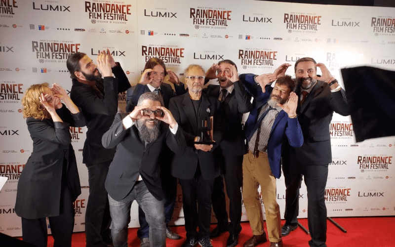 People posing for a picture at Raindance film fest.
