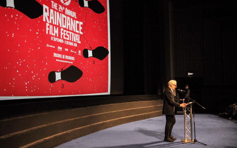 Elliot Grove giving a speech at a Raindance film festival.