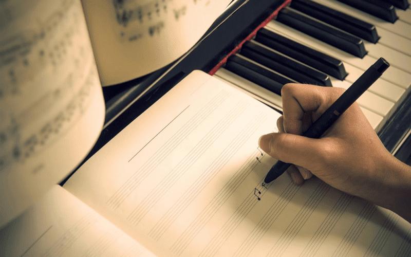 music composer writing music