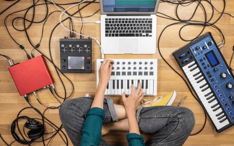 artist making music on computer