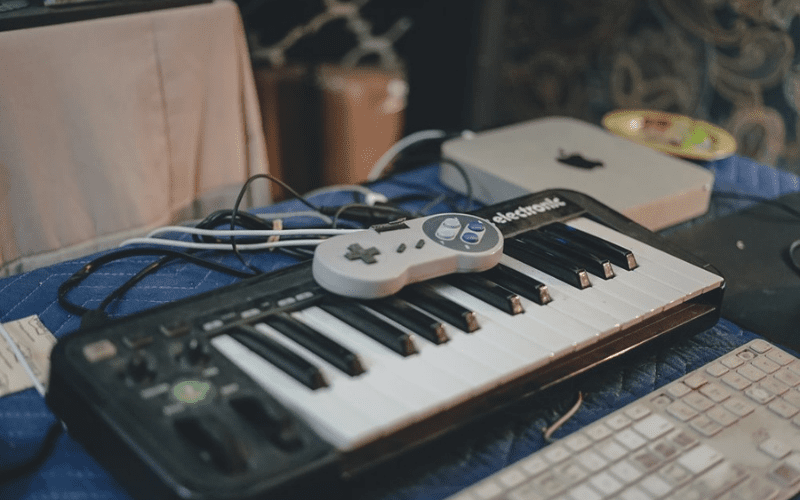 game controller on piano video game music composer