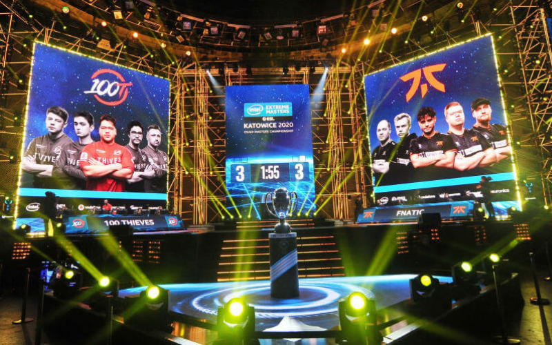 esports event with two teams and a trophy championship