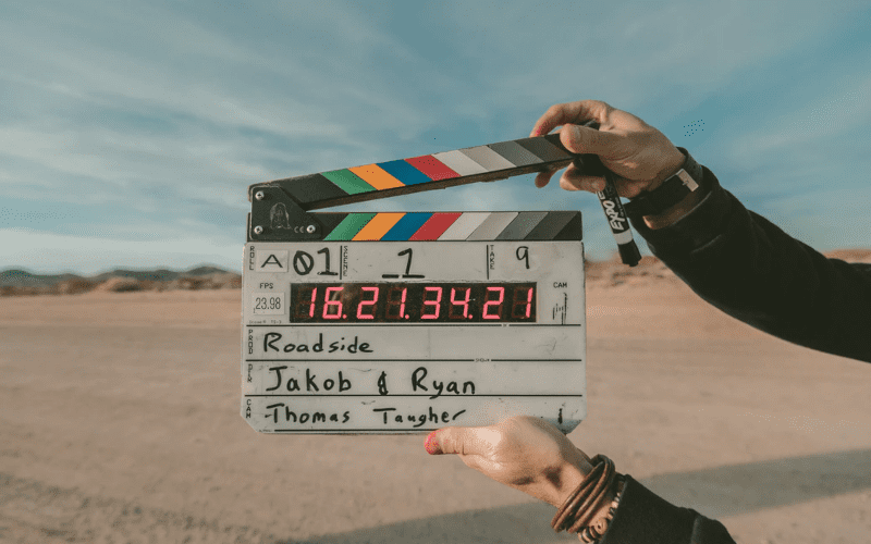 A clapperboard being held in a desert, ways to end a story