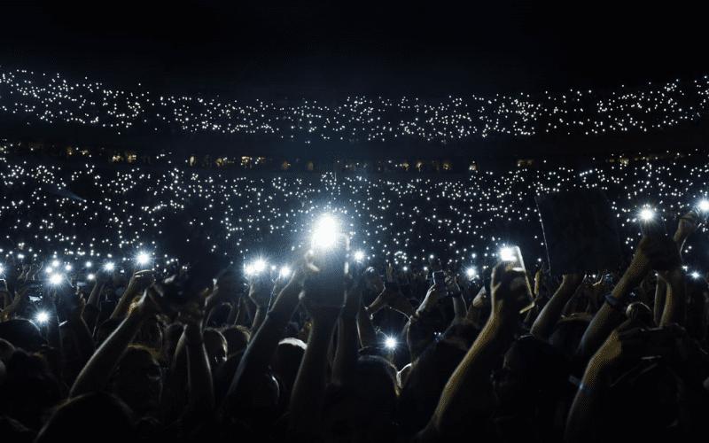 phones at a concert flash