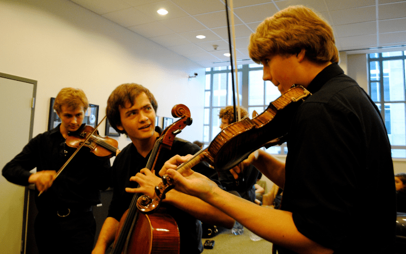 concert etiquette warm up behind stage classical musicians