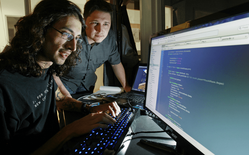 Two game developers discuss their programming