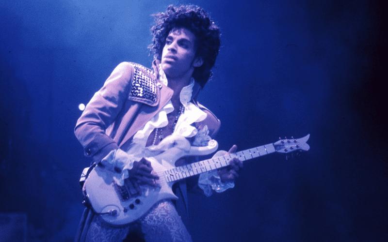 prince performing playing guitar