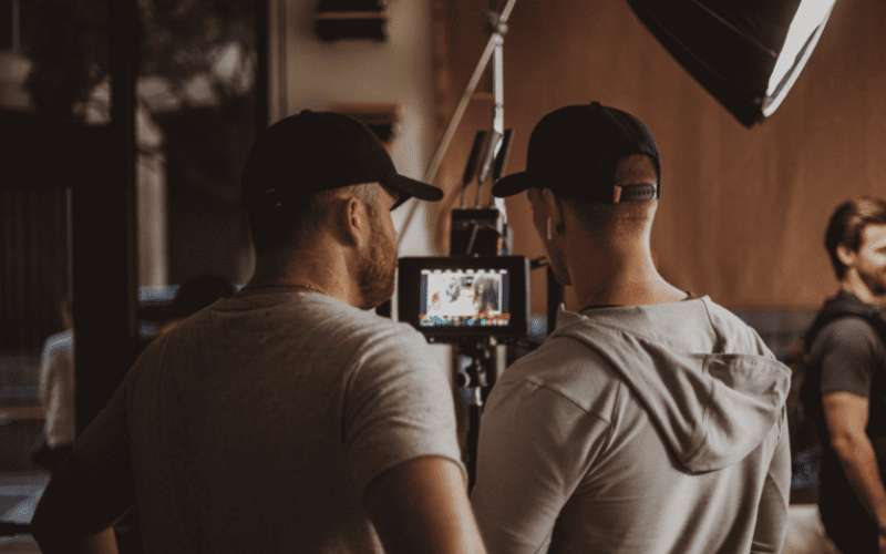 people working with a camera on set