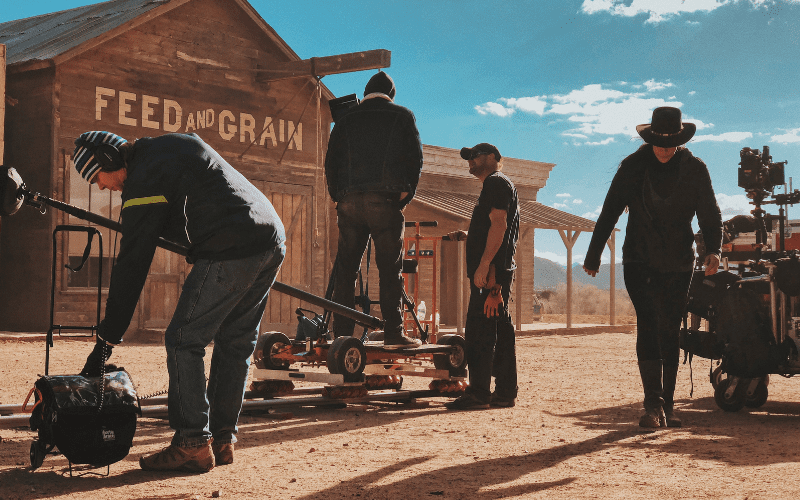 Prop masters on the set of a Western film