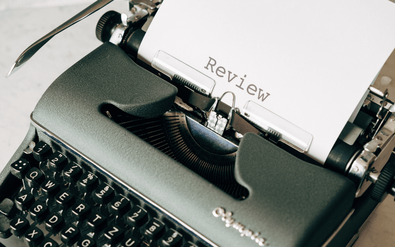 typewriter with film critic review