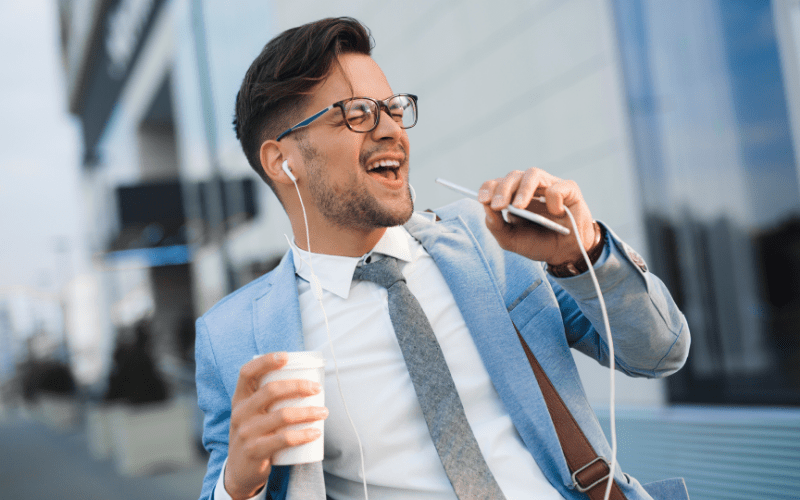 music manager singing into phone