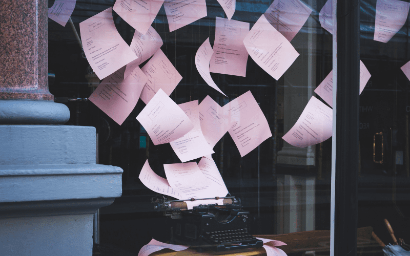 typewriter with paper flying out of it