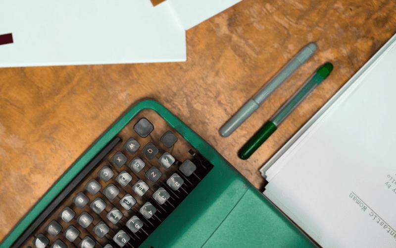 typewriter and pens stock photo