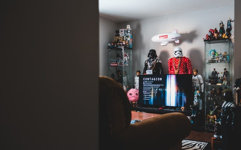 room of collectibles with netflix on tv