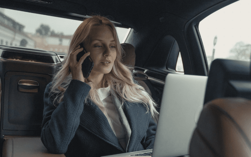 manager in a car on the phone