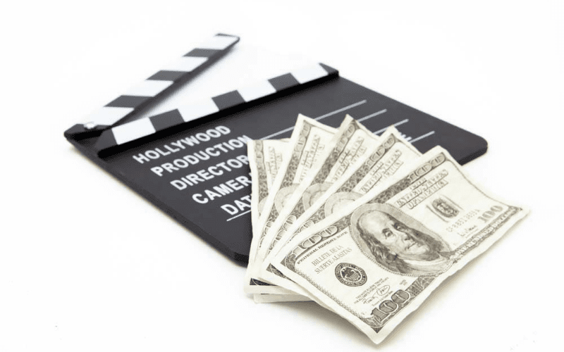 movie clapboard with money