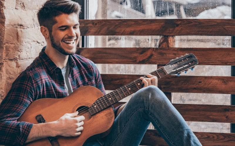 musician playing and smiling