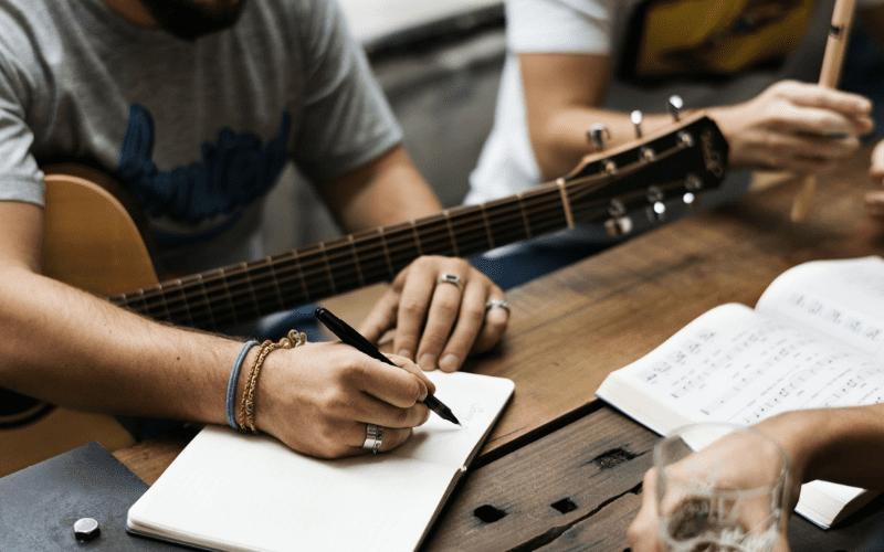 guitar player musicians writing music