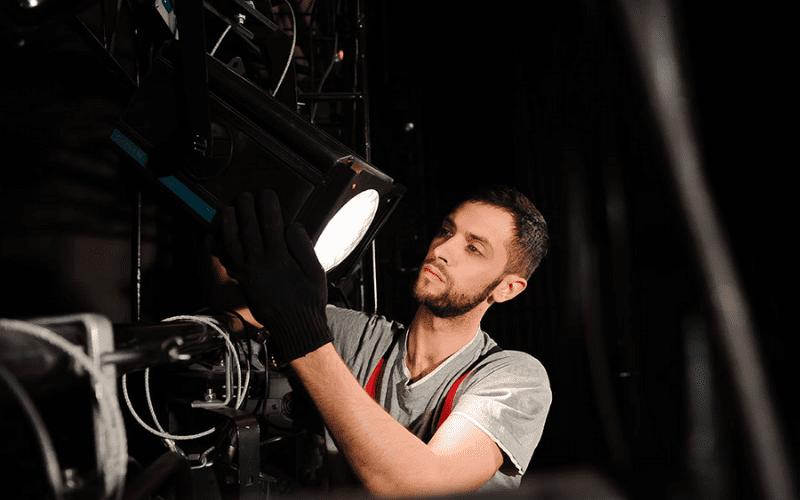 Set designer helping with equipment