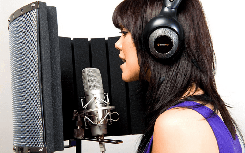 A background singer in their home studio