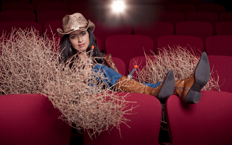 Woman dressed as cowgirl in the cinema