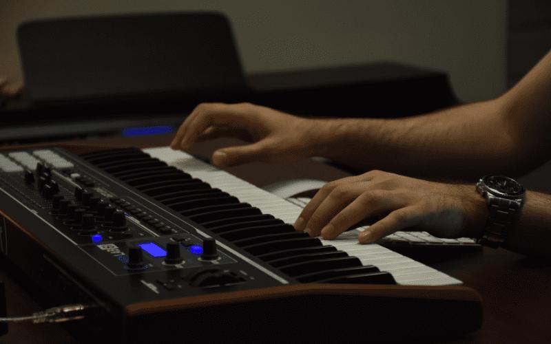 someone playing a keyboard