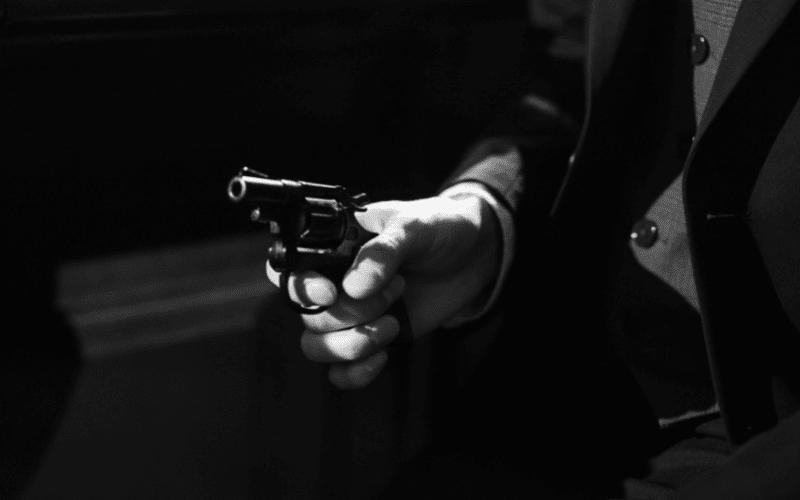 A spy movie protagonist holding a pistol