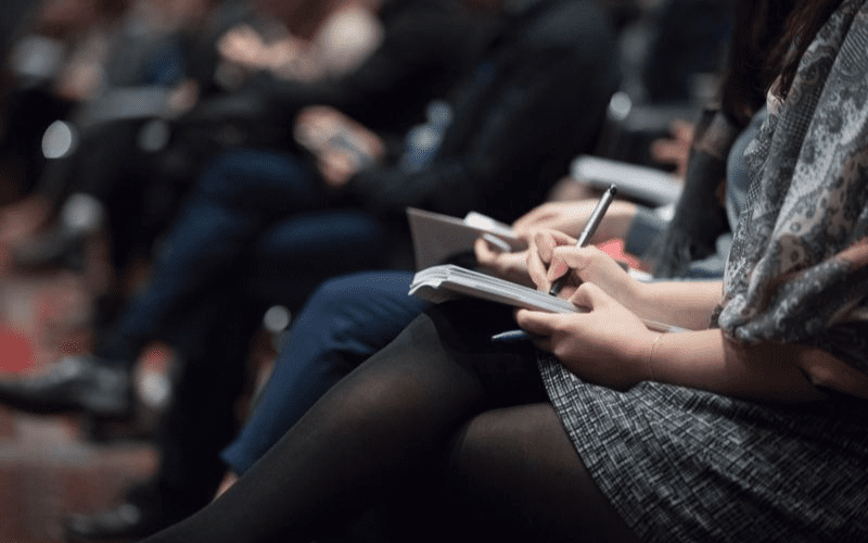 taking notes at networking event