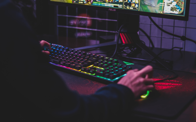 pc gaming vs console person using gaming keyboard