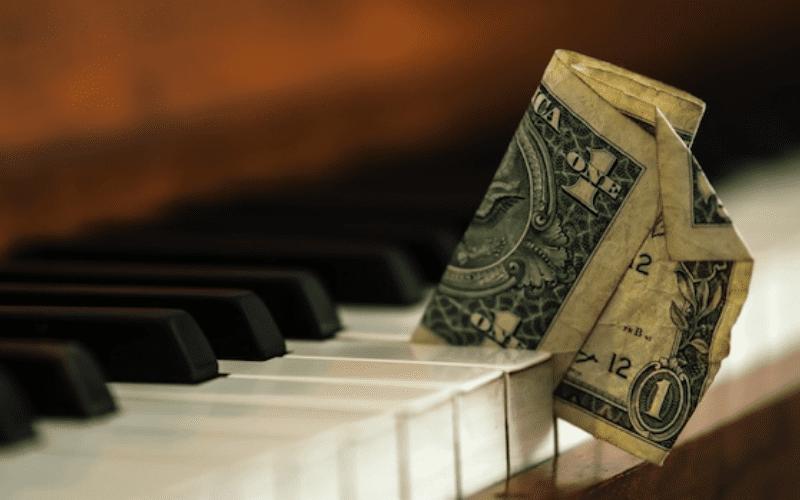 piano with money