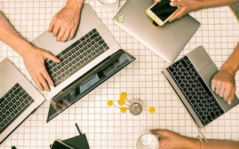 multiple people on laptops