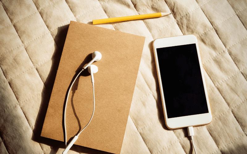 phone headphones and notebook