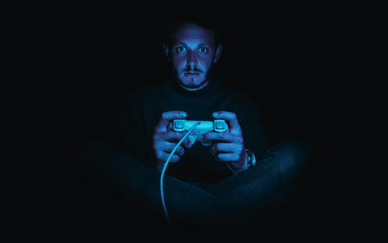 man playing console game