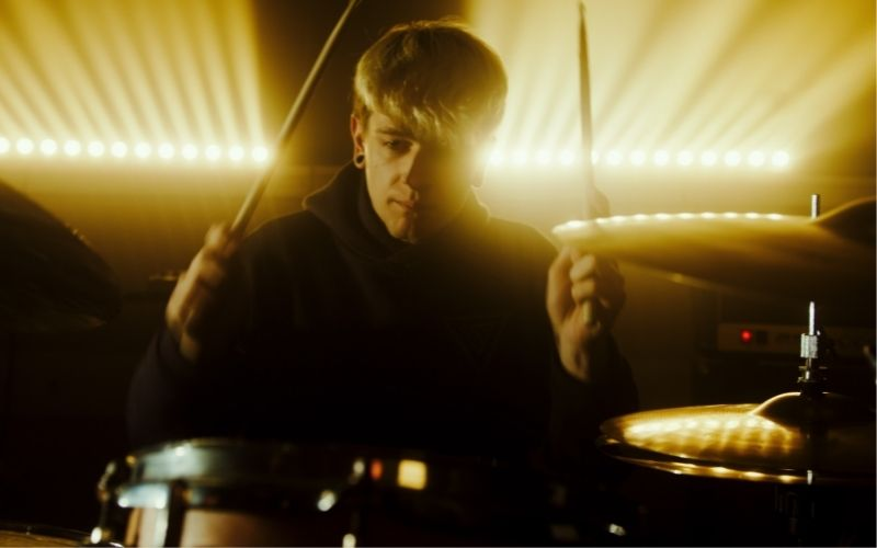 musician playing the drums